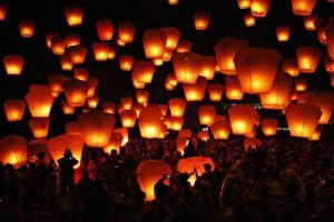 People release sky lanterns to celebrate the traditional Chinese Sky Lantern Festival in Pingsi, Taipei County
