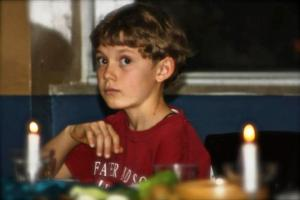 Boy at Seder Meal
